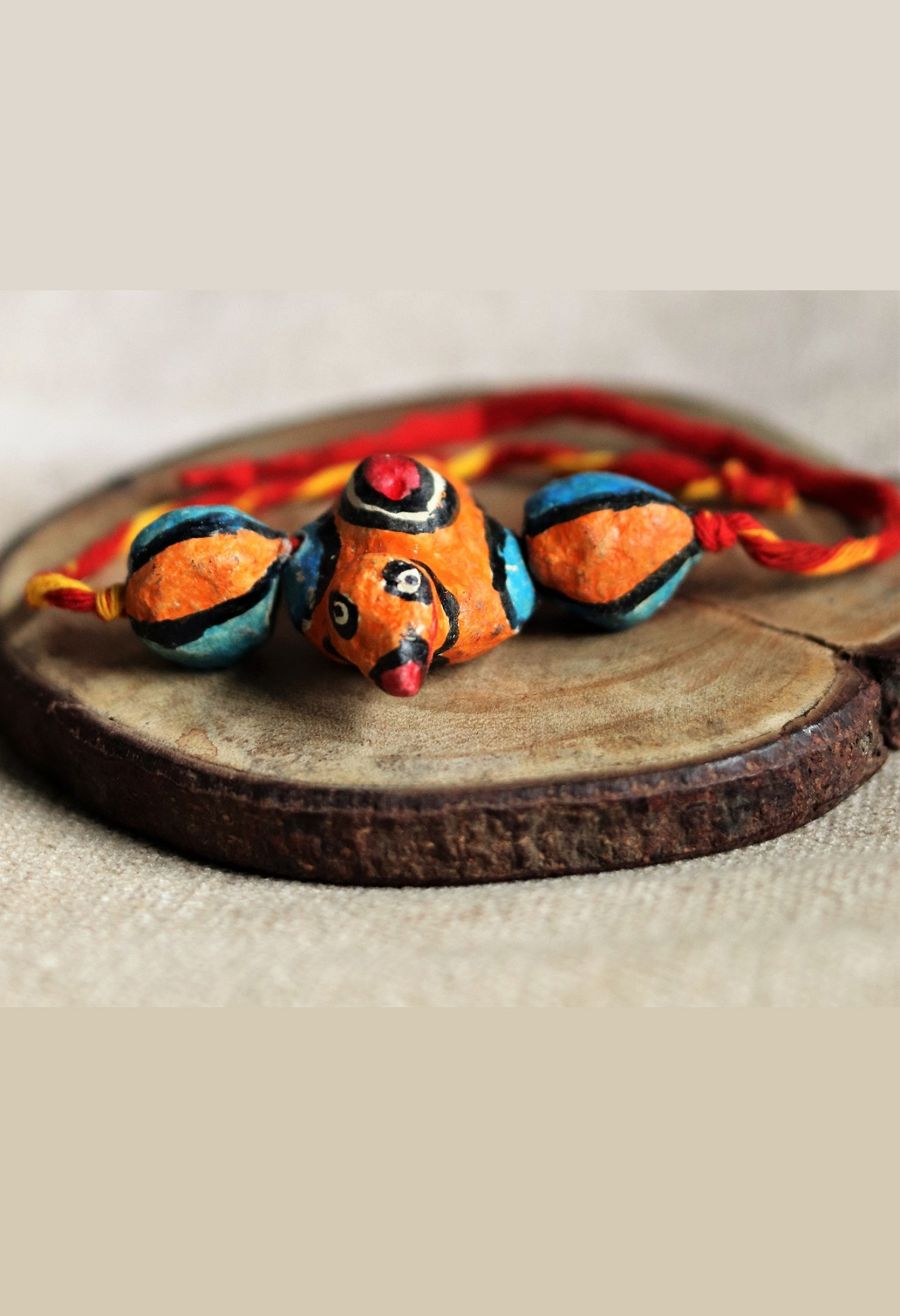 Papier Mache Orange Parrot Rakhi